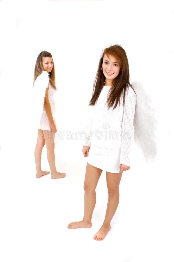 Angelic Pair 2. Two smiling barefoot winged angels standing separately royalty free stock photo