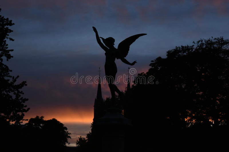 Angelic sunset. Great sunset over the sky with presence of the night angel stock photo