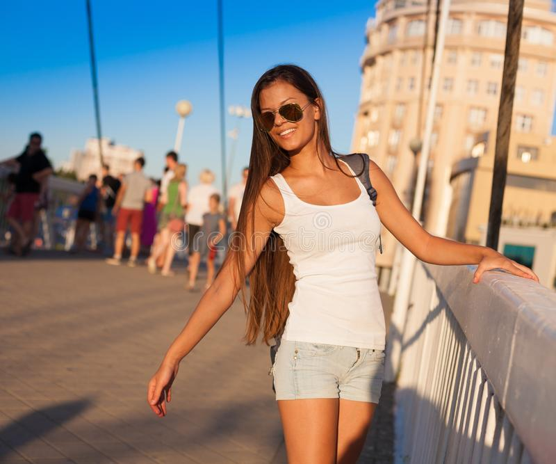 Angelica. tourist blue sky sunglasses white shirt blue jeans sho. Beautiful sensuality elegance brunette woman, has happy fun cheerful smiling face, white t stock images