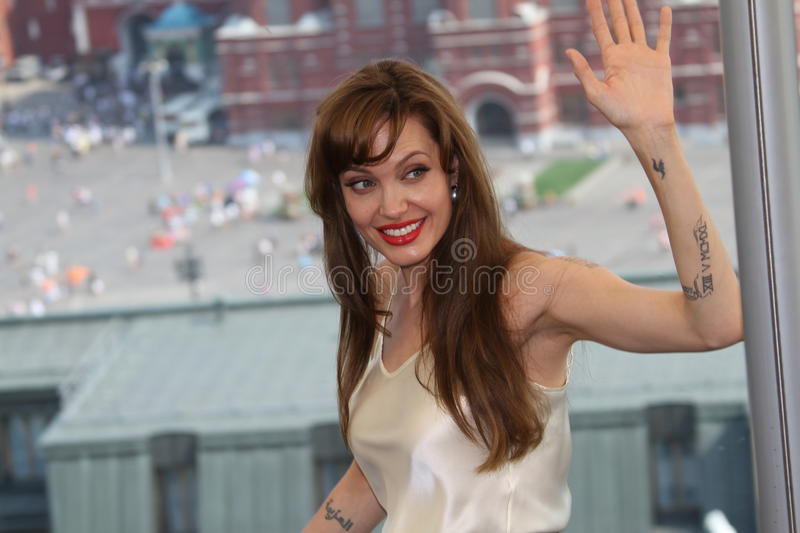 Angelina Jolie. MOSCOW, RUSSIA - JULY 25: US actress Angelina Jolie poses for a photocall on the roof of Ritz hotel in on July 25, 2010 in Moscow, Russia stock image
