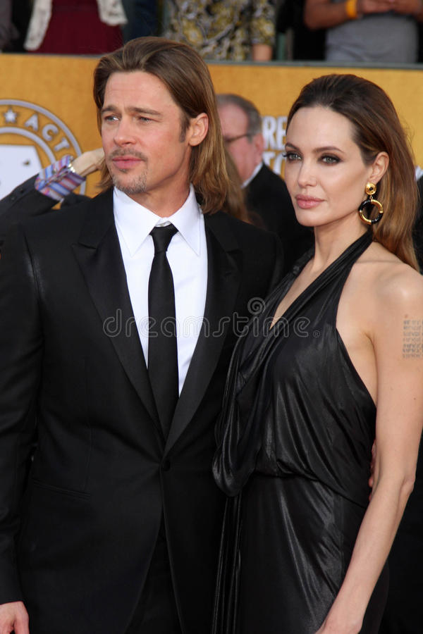 Angelina Jolie, Brad Pitt. LOS ANGELES - JAN 29: Brad Pitt and Angelina Jolie arrives at the 18th Annual Screen Actors Guild Awards at Shrine Auditorium on royalty free stock images