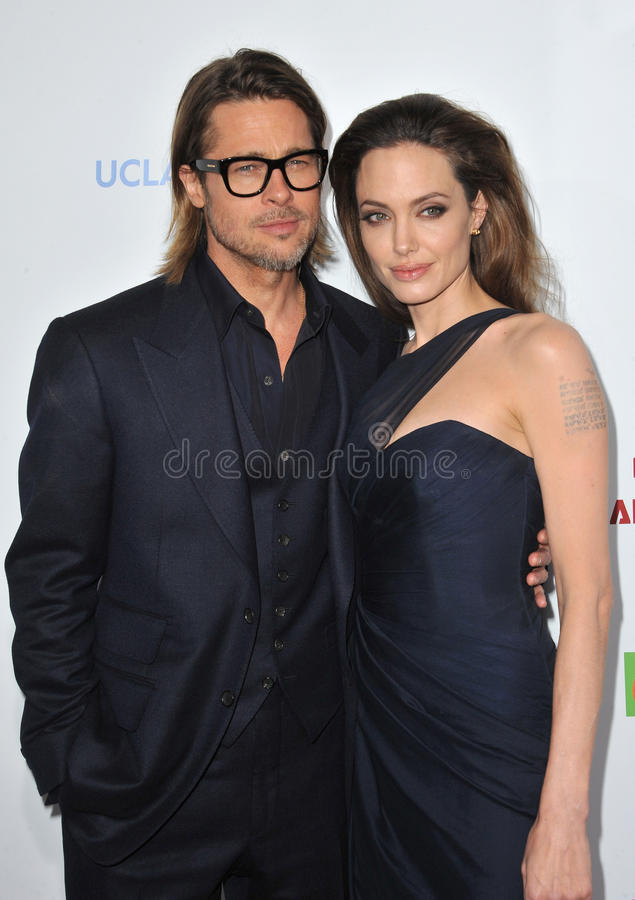 Angelina Jolie, Brad Pitt, Paul Smith stock foto's
