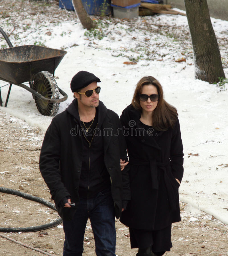 ANGELINA JOLIE AND BRAD PITT. On the set of her directorial debut, a Bosnian war love drama, currently in production in Budapest, Hungary, on Tuesday, November royalty free stock photography