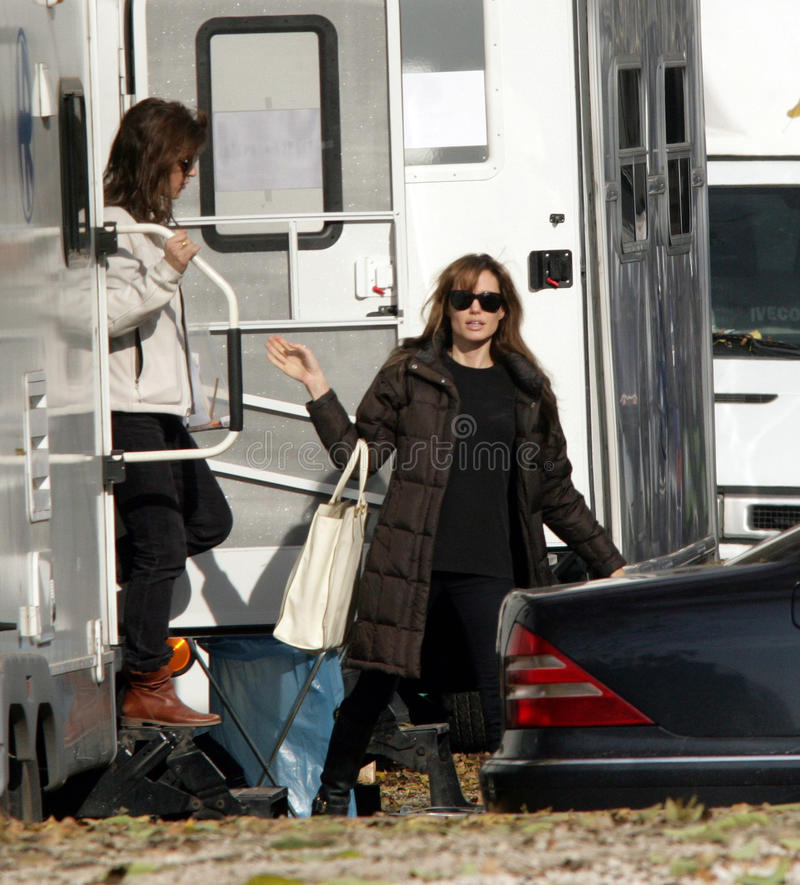 ANGELINA JOLIE. Carrying an oversized white handbag, leaves her trailer on the set of her directorial debut, now in production, in Budapest, Hungary, on royalty free stock photos