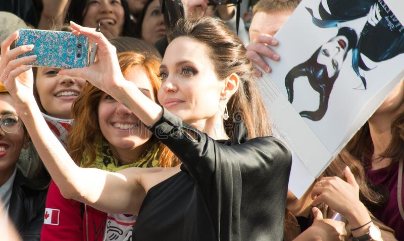 Angelina Jolie World Premiere of `First They Killed My Father` at Toronto International Film Festival. Angelina Jolie with fans at the Premiere of Netflix`s Film royalty free stock photos