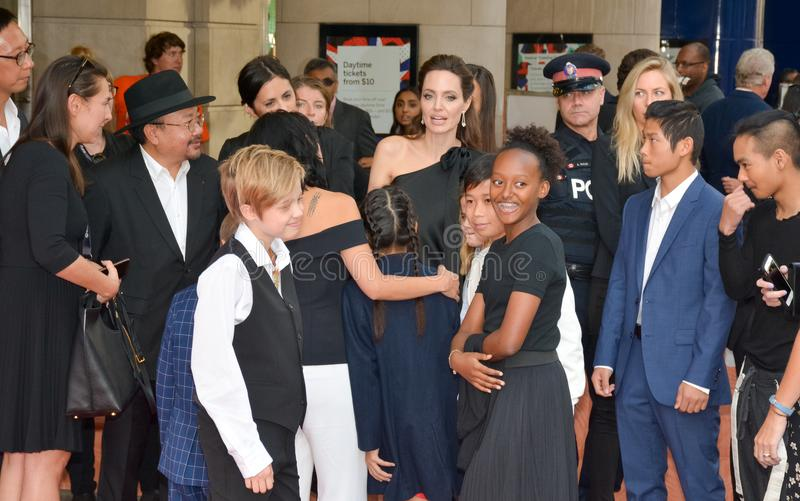 Angelina Jolie World Premiere of `First They Killed My Father` at Toronto International Film Festival. Angelina Jolie gathering her kidsfor a photo op at the stock image
