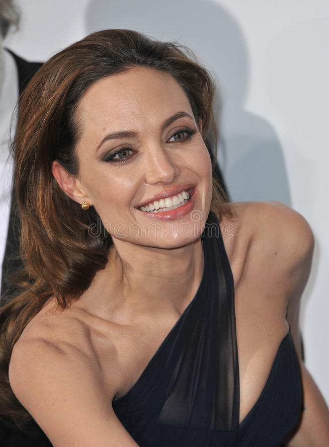 Angelina Jolie, Paul Smith. Angelina Jolie at the Los Angeles premiere of her new movie In The Land of Blood and Honey, which she wrote & directed, at the stock images
