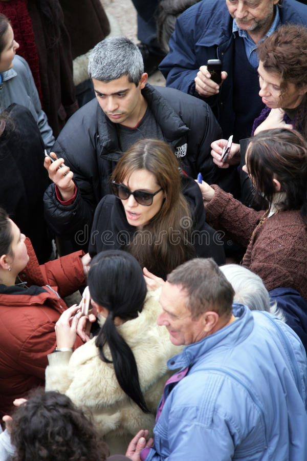 ANGELINA JOLIE. Signs autographs and takes photos with extras and fans on the set of her directorial debut currently in production in Budapest, Hungary, on royalty free stock photography