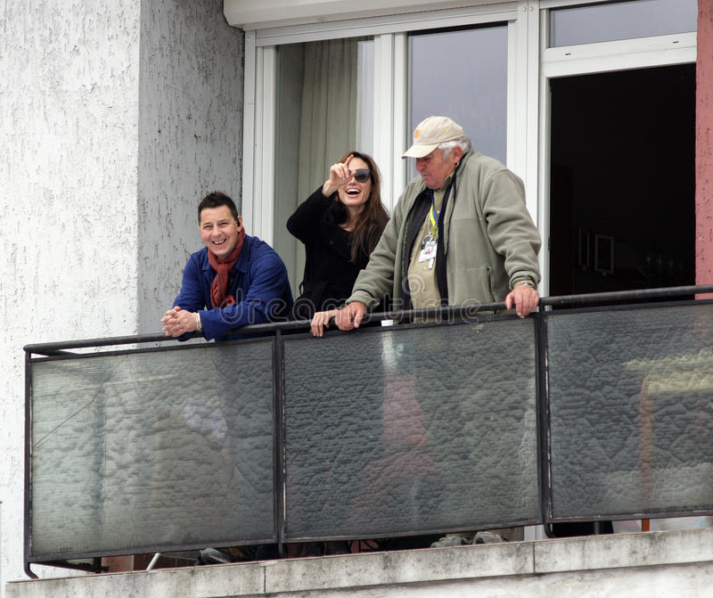 ANGELINA JOLIE. And two members of her crew look out over the set of her directorial debut, a Bosnian war love drama, currently in production in Budapest royalty free stock photos