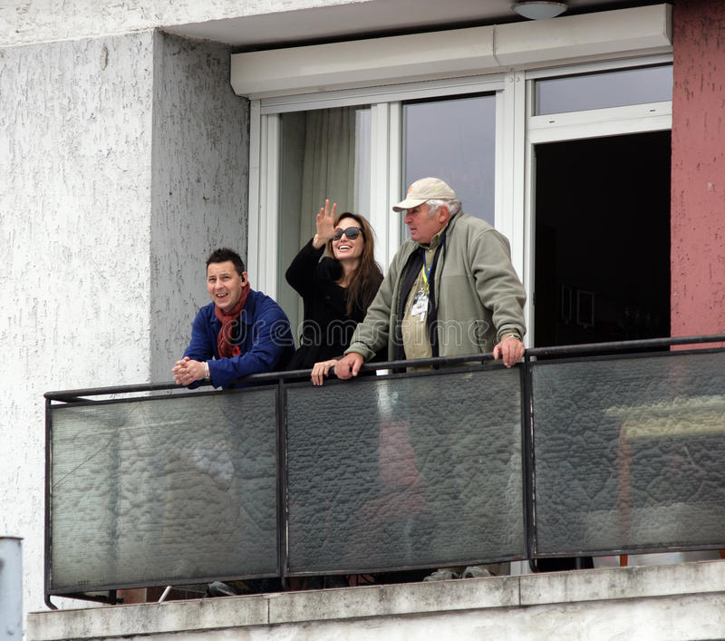 ANGELINA JOLIE. And two members of her crew look out over the set of her directorial debut, a Bosnian war love drama, currently in production in Budapest stock photos