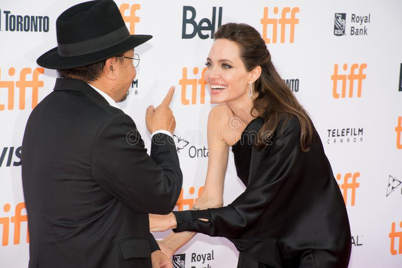Angelina Jolie World Premiere of `First They Killed My Father` at Toronto International Film Festival. Angelina Jolie and Rithy Panh at the Premiere of Netflix`s stock photo
