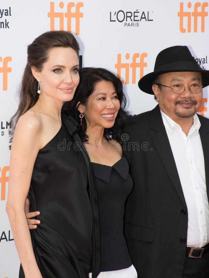 Angelina Jolie World Premiere of `First They Killed My Father` at Toronto International Film Festival. L-R Angelina Jolie, Loung Ung, and Rithy Panh at the royalty free stock image