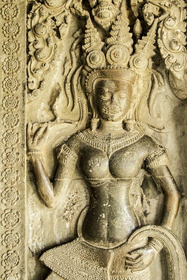 Angelo avuto bisogno arenaria sulla parete di Angkor Wat, Cambogia fotografia stock