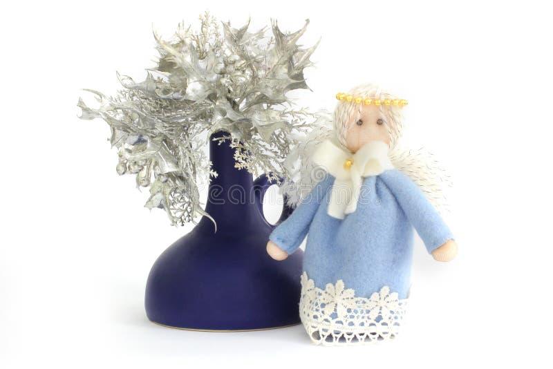 Angelo di Natale e fiori di Natale immagine stock libera da diritti