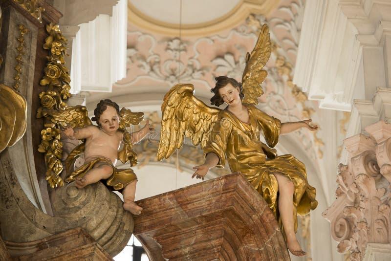 Angelo e Putto in st Peters Church Munich fotografia stock