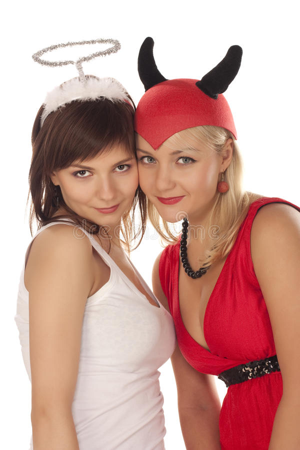 Angelo e ragazze del diavolo sopra bianco fotografie stock