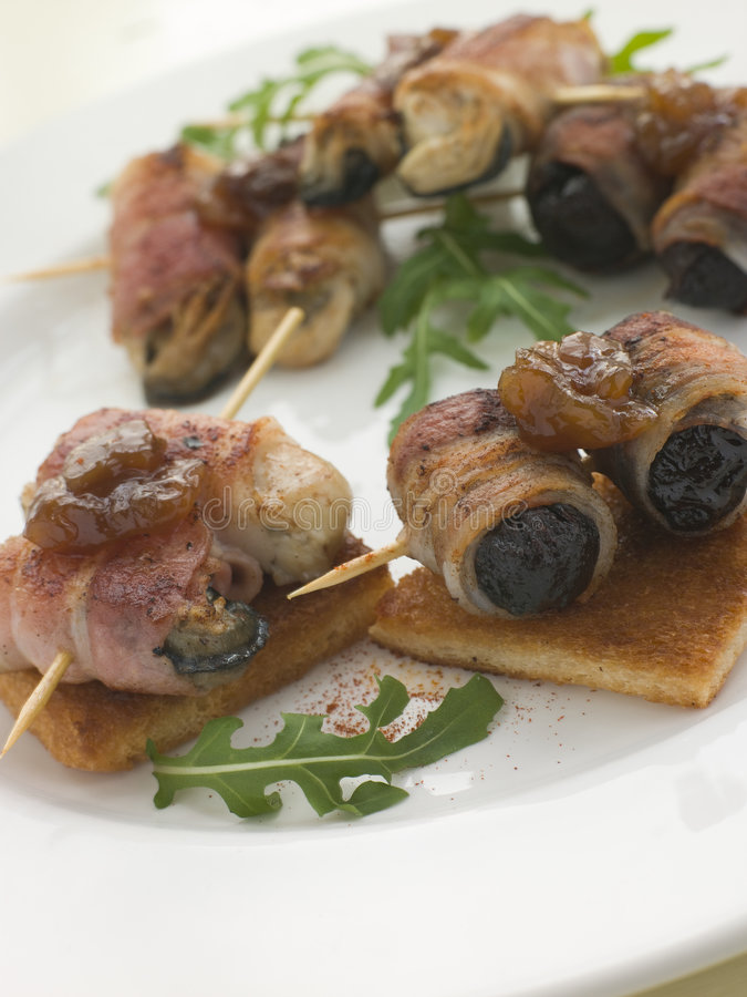 Free Angels And Devils On Horseback On Toasts Royalty Free Stock Photo - 5626715