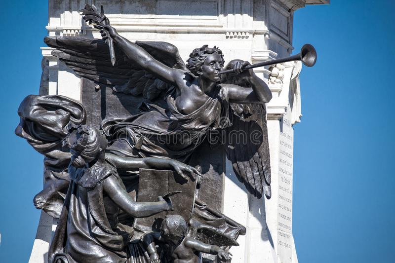 Angels blowing horn on Samuel de Champlain Statue in Quebec City Canada. With blue sky in background stock photo