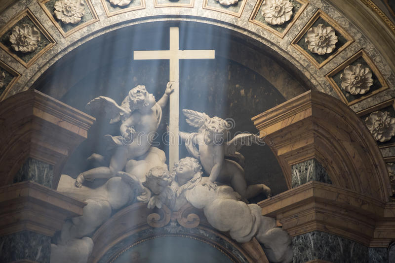 Light incidence - Angels holding Cross, Cathedral Bologna royalty free stock photo