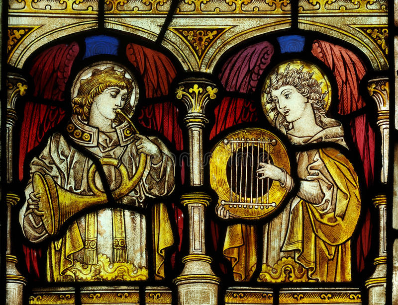 Angels making music (stained glass). A photo of angels making music (stained glass royalty free stock photos