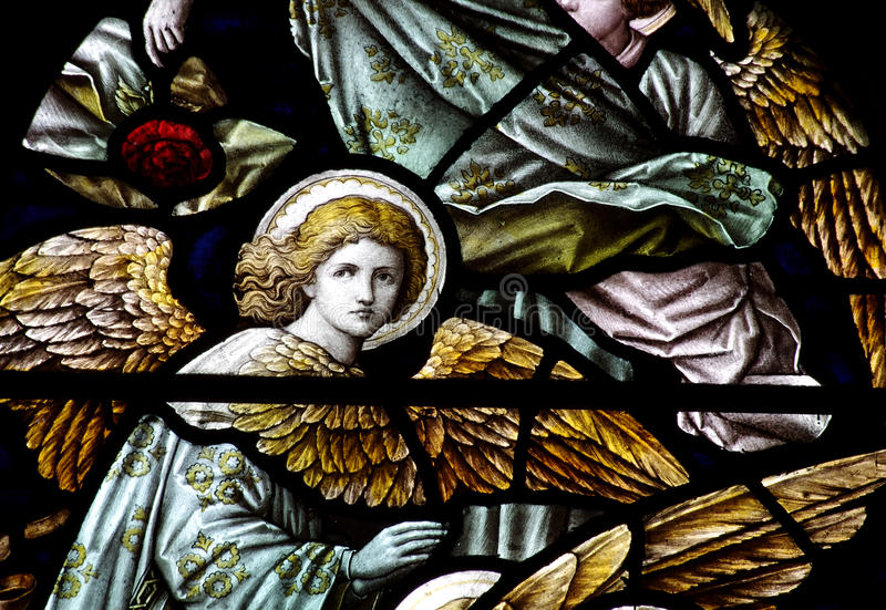 An angels in stained glass. A photo of an angle in stained glass stock photography