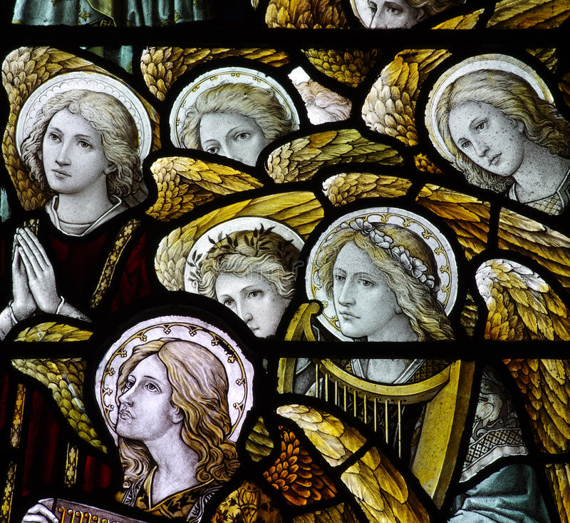Angels in stained glass. A photo of angles in stained glass royalty free stock photo
