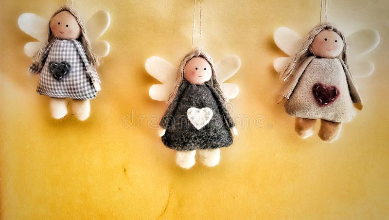 Angels. Three Angels on the wall stock photo