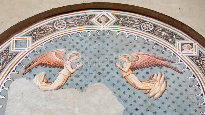 Angels on wall painting, fresco in Basilica San Domenico Siena, interior of Church, Tuscany, Italy royalty free stock images