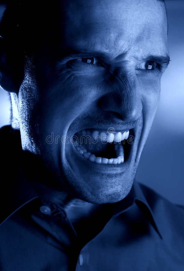 Anger. Angry men head shoot monochrome - night concept stock image