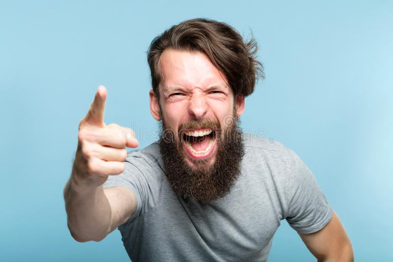 Anger fury rage accusation man screaming blaming. Anger fury rage and accusation concept. bearded man screaming and blaming someone and pointing finger royalty free stock image