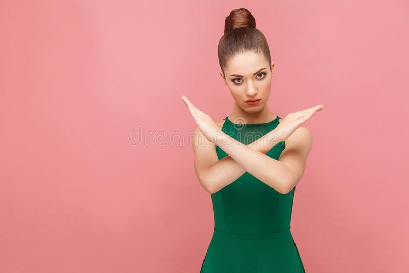 Anger woman showing hand stop sign. Expression emotion and feelings concept. Studio shot, on pink background royalty free stock images