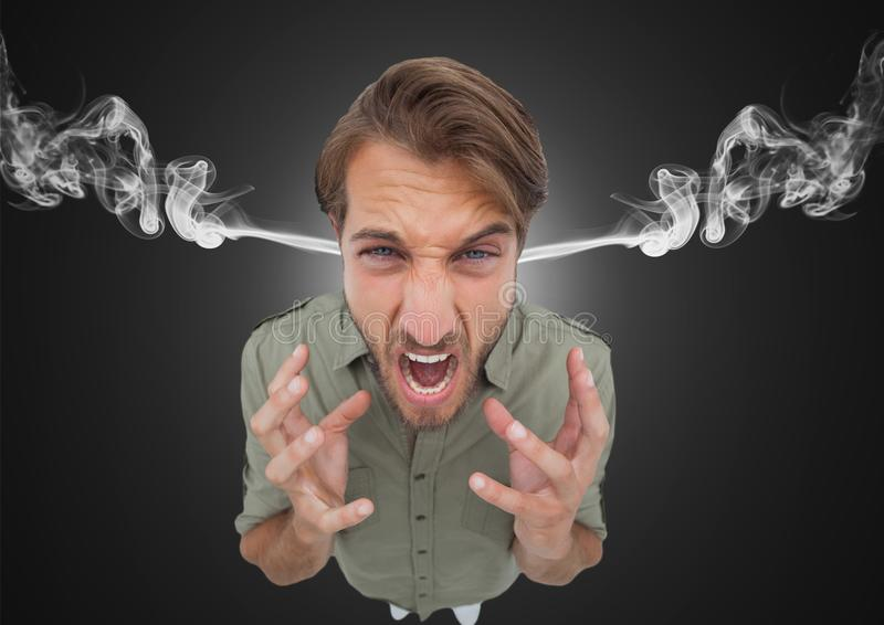 anger young man with steam on ears. Black background stock image
