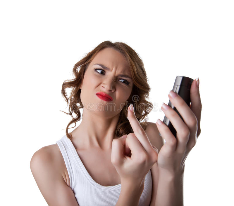 Anger Young woman show finger on cell phone. Isolated royalty free stock photos