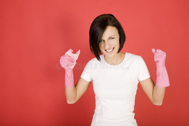 Angery cleaning woman stock image