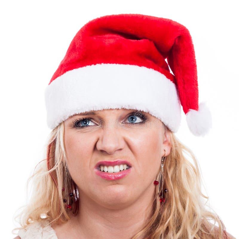 Angewidertes Weihnachtsfrauengesicht stockbild