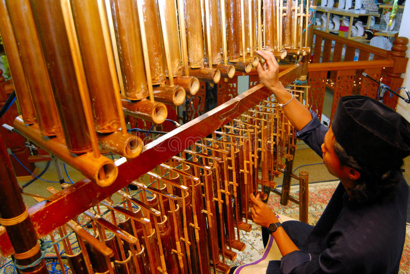 Angklung musical insrtument. The Angklung is a musical instrument made of two bamboo tubes attached to a bamboo frame. The tubes are carved to have a resonant royalty free stock image