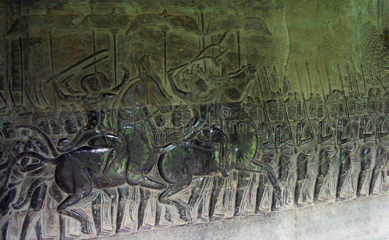 angkor bas Cambodia przeprowadzać żniwa siem reliefowego wat obrazy stock