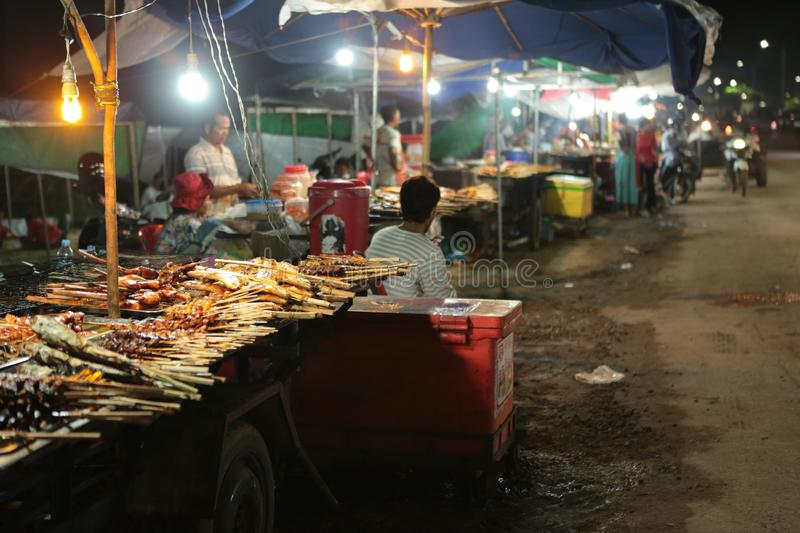 Night market in the street of Siem reap. The angkor night market in Siem Reap is one of the oldest night market in Cambodia. You can find many things as food and royalty free stock photo