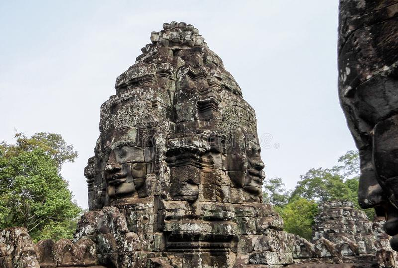 Angkor Thom med att le buddha vänder mot på Angkor Wat Temple - Siem Reap, Cambodja arkivfoton