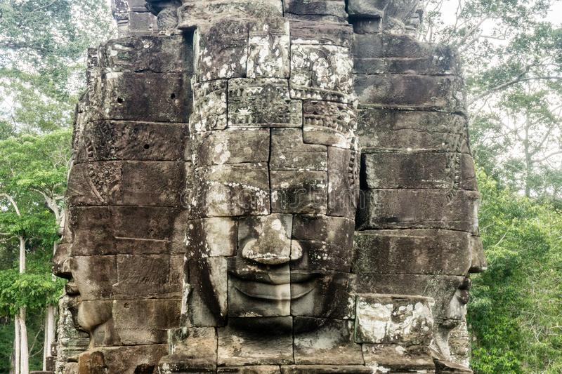 Giant Stone Face in Tample near Angkor Wa royalty free stock photo