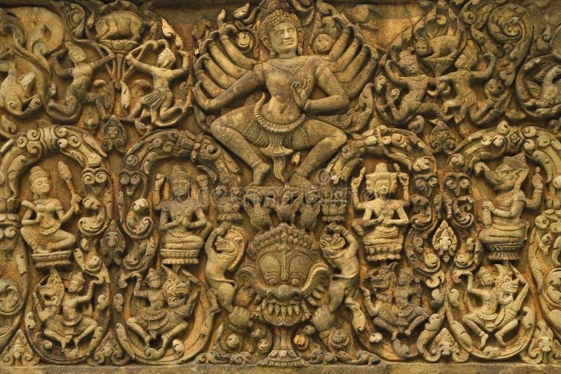 Angkor Wat art of ancient Hindu god stone royalty free stock photography