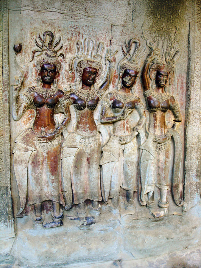 Angkor Wat, bas-relief. Cambodia. Bas-reliefs of the heavenly inhabitants - the demigods (devatas, at Khmer - tevoda), widespread in Hindu and Buddhist royalty free stock image