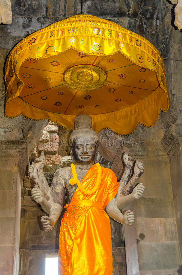 Angkor Wat complex - Statue of Vishnu with eight arms stock photography