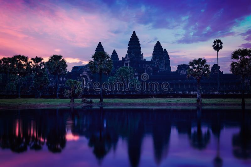 Angkor Wat - famous Cambodian landmark - on sunrise. Vintage retro effect filtered hipster style image of Angkor Wat - famous Cambodian landmark - on sunrise royalty free stock photos