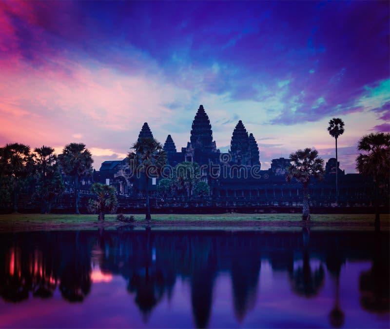 Angkor Wat - famous Cambodian landmark on sunrise. Vintage retro effect filtered hipster style image of Angkor Wat - famous Cambodian landmark - on sunrise. Siem stock photos