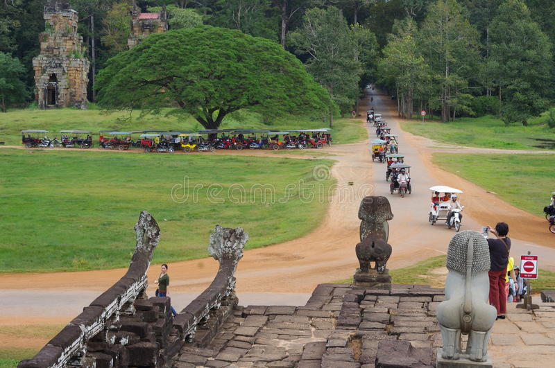 Returning tuk tuks at city of Angkor Thom stock photography