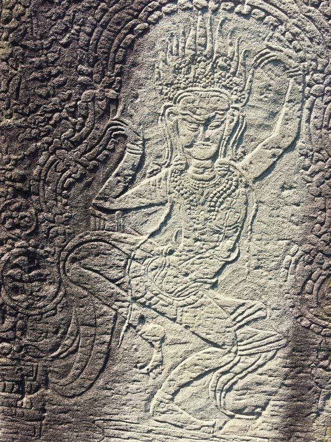 Angkor Wat i Siem Reap, Cambodia Apsara sned på väggen av den forntida templet för en khmer arkivbild