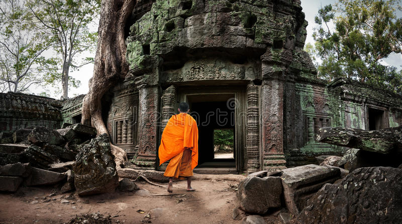 Angkor Wat monk. Ta Prom Khmer ancient Buddhist temple in jungle stock photos