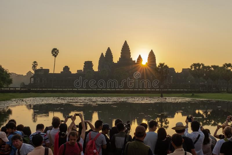 Angkor Wat, Siem Reap, Cambodia, November, 4, 2014: A large crowd of photographers all gathered round the edge of a lake royalty free stock photos