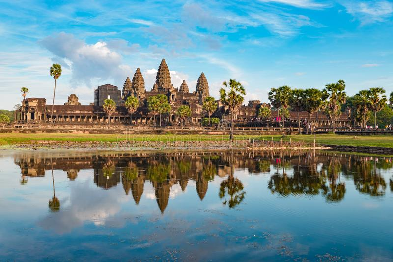 Angkor Wat sunny day blue sky main facade reflection on water pond sunset light. World famous temple in Cambodia, tourist travel royalty free stock photos